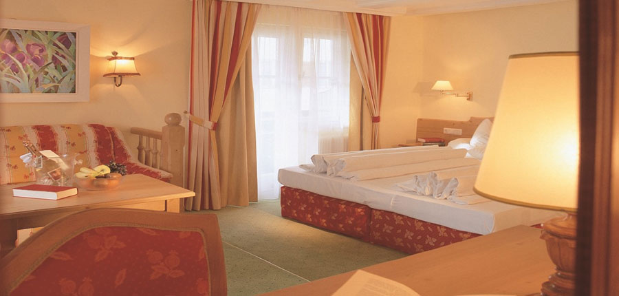 Sporthotel Igls, Igls, Austria - bedroom with seating area.jpg